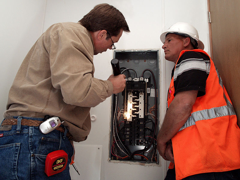 Building inspector examining wiring in California